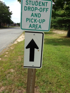 Signs along the driveway direct driver who are dropping off students to go to the side bus loop.