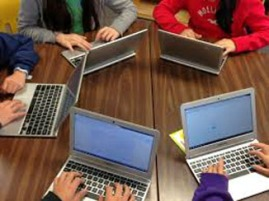 student w chromebook in group