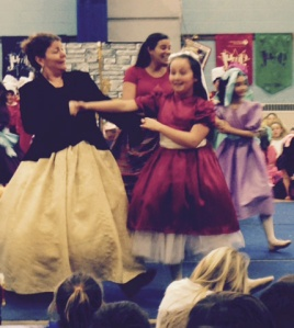 Clara's sister Molly (Maddie Baecker) dancing with a Party-Goer (Mrs. Lemay)