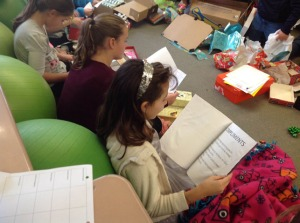 "Students read the stories contained in their ""Boxes of Hope"""