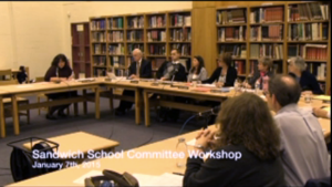 Michelle Austin explained the Summary of the Budget and the Salaries at each site. Photo from the SCT video.