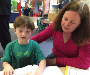 A talented young author reads to his proud mom.