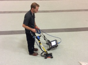 This photo, taken in May, shows the sonar equipment being used to check for water under the pool.