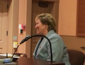 Dr. Gould reacted with smiles to the committee's unanimous vote to ratify her contract.